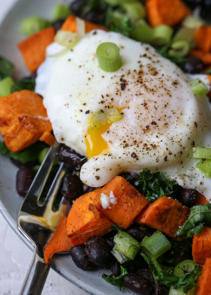 Sheet Pan Sweet Potato, Black Bean, & Kale Breakfast Hash recipe - An easy, hearty breakfast that cooks up on a sheet pan (and makes perfect leftovers for later in the week)!