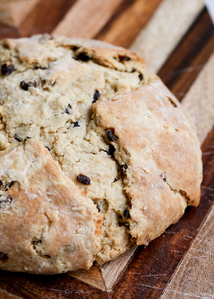 Vegan Irish Soda Bread - Golden-brown deliciousness that tastes just like the original. Just because you're vegan or dairy-free doesn't mean you can't enjoy a little bread-o-the-Irish!