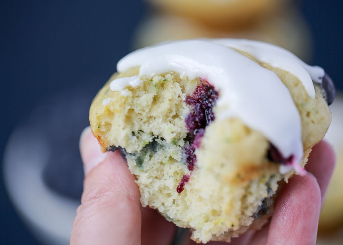 Zucchini Lemon Blueberry Muffins - Moist and lemony with flecks of zucchini and bursts of blueberry. These summery muffins are a new seasonal favorite around here!