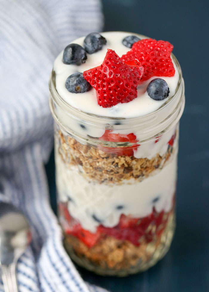 Strawberries, blueberries, granola, and yogurt (vegan if you prefer), all layered up.