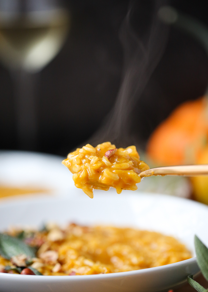 Creamy Vegan Pumpkin Risotto - A surprisingly simple autumnal risotto made with pumpkin puree and a secret ingredient for an umami boost. Plus, a toasted hazelnut and crispy fried sage leaf garnish that take it over the top! #veganrisotto #fallrisotto #veganpumpkinrisotto
