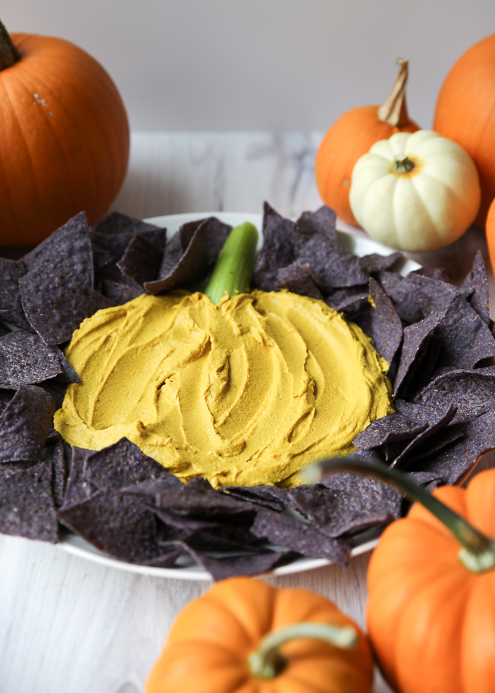Curried Pumpkin Hummus - Harvest hummus to the fall potluck rescue! This easy app is perfect to bring along to parties, or just keep a batch in the fridge to enjoy for yourself.