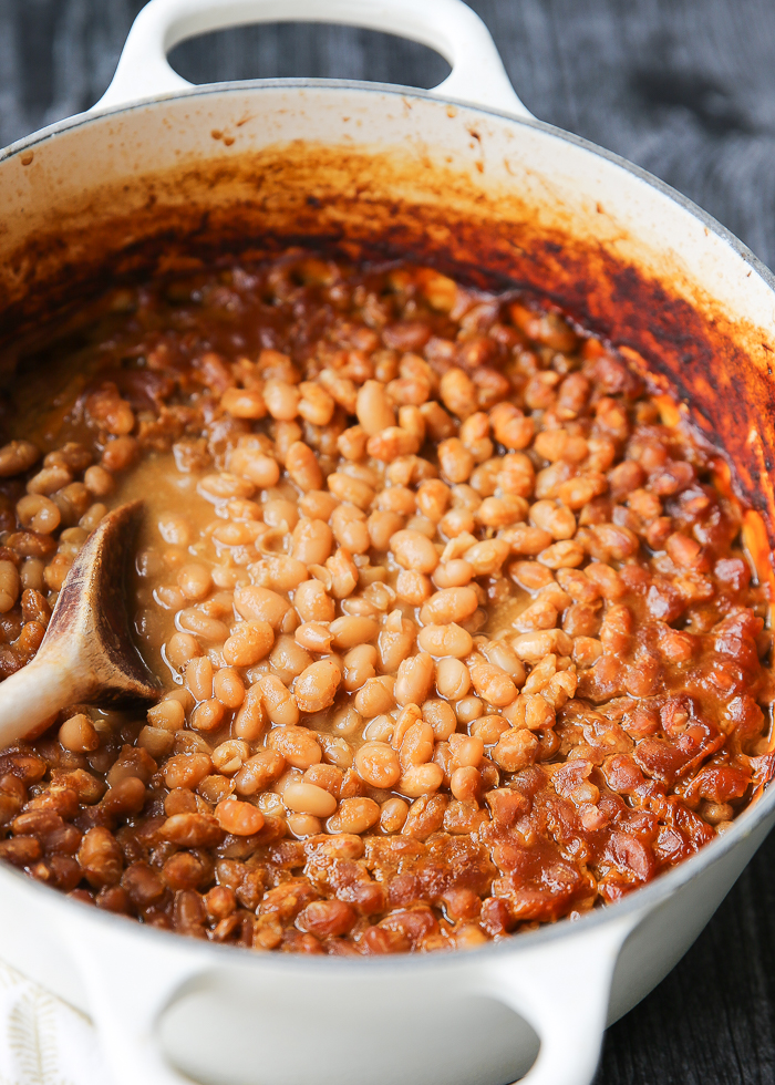 Maple Miso Vegan Baked Beans - Miso, maple, garlic, and other seasonings make for a flavor bomb of a baked bean situation. The perfect vegan potluck dish!
