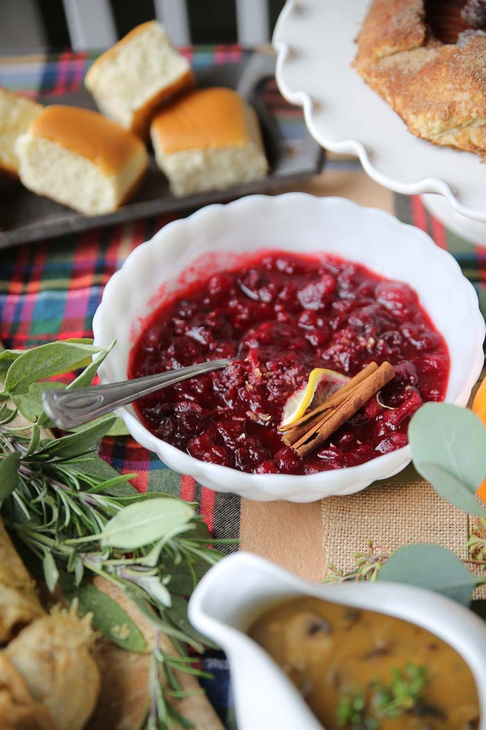 Maple Spiced Cranberry Sauce - Homemade cranberry sauce cranked up a notch, with pure maple syrup and brown sugar, lemon zest, and a litany of warming, elevating spices.