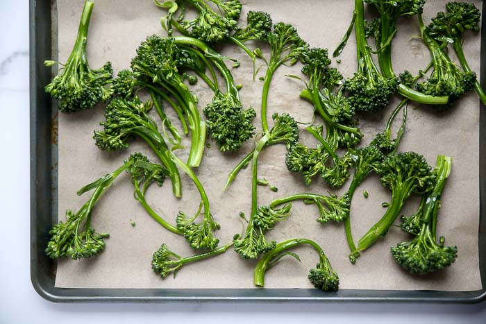 Super Simple Sesame Roasted Broccolini recipe - This super simple side whips up quickly and is super tasty. I'm marketing it as a side, but I've also been known to just eat it as a snack, like fries!