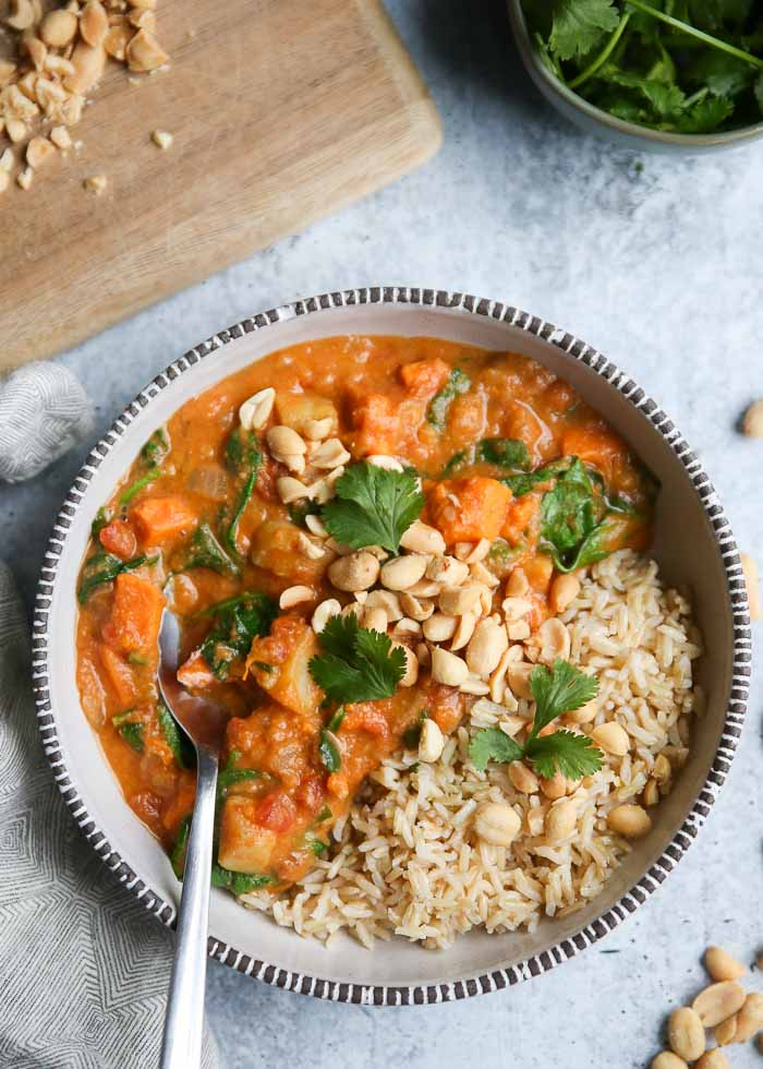 West African Peanut Stew with Sweet Potatoes & Spinach - Sweet potatoes, peanut butter, spinach, cumin ... the comforting combo results in the heartiest, most flavorful stew around.