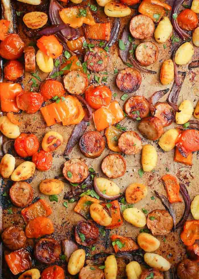 Crispy Sheet Pan Gnocchi with Veggies & Sausage (Vegan or Meaty!) - Assembled on two sheet pans to separate the meaty from the meatless, this easy-to-make dinner boasts veggies, sausage/vegan sausage, and gnocchi roasted to golden perfection.