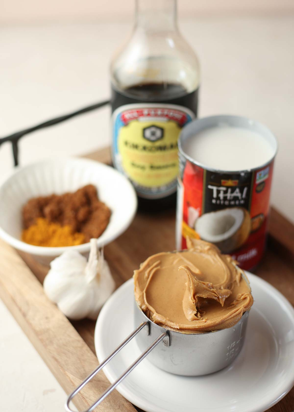 Our Very Favorite Homemade Peanut Sauce Recipe - Just six ingredients make up this rich and savory peanut sauce. Drizzle it over tofu, chicken, and broccoli or dip your favorite veggies in. Versatile and addicting!